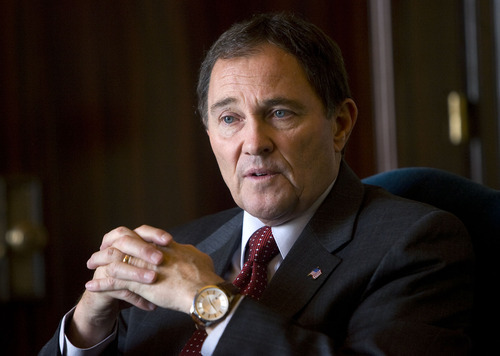 Tribune File Photo  Gov. Gary Herbert on Thursday signed a controversial congressional redistricting map, saying it is reasonable. Democrats have vowed to sue, saying it is a product of partisan gerrymandering intended to ensure all four U.S. House members from Utah are Republican.