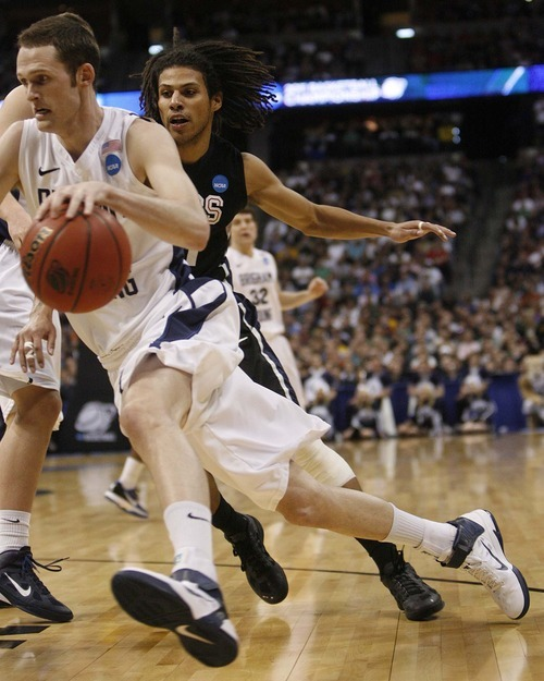 Trent Nelson     The Salt Lake Tribune BYU's Stephen Rogers drives past Gonzaga's Steven Gray as BYU faces Gonzaga in the NCAA Tournament, men's college basketball at the Pepsi Center in Denver, Colorado, Saturday, March 19, 2011.