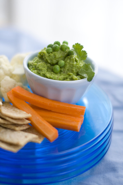 This sweet pea and avocado guacamole guacamole is a spring-inspired version of the classic dip, and has a fresh, crisp flavor that is brightened by plenty of fire-roasted chiles, lime juice and chopped fresh cilantro. Use this dip as you would a traditional guacamole. Or for a refreshing variation, serve with a plate of sliced bell peppers and carrot sticks.     (AP Photo/Matthew Mead)