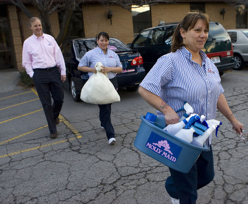 Al Hartmann  |  The Salt Lake Tribune Molly Miad employees Donna Montoya, right, and Esmeralda Mendoza, center, head to the fleet of Molly Maid Cars to go out on a cleaning job. Alan Green, left, 59, a veteran businessman, now owns a Molly Maid franchise in the valley.