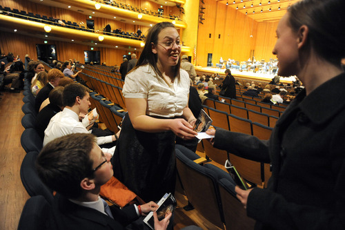 Sarah A. Miller  |  The Salt Lake Tribune  Shanae Tate, 17, gives a program to Hanne Blomgren, 15, at the Utah Symphony concert at Abravanel Hall in Salt Lake City in February. The students are members of the new West High School Symphony Club.