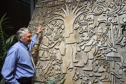 Trent Nelson  |  The Salt Lake Tribune Ronald Lowe explains details in a replica of Izapa Stela 5, or