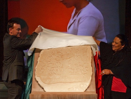 Trent Nelson  |  The Salt Lake Tribune West Valley City Mayor Michael Winder and Rhosby Barker of Casa Chiapas unveil a replica of Izapa Stela 5, or