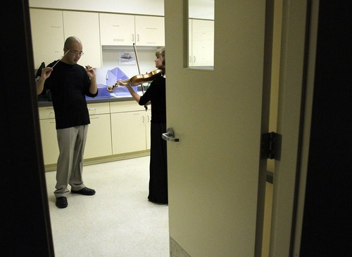 Stephen Holt | Special to The Salt Lake Tribune Gifted Music School  director Eugene Watanabe practices with Emily Richards in the kitchen moments before they perform in the All-Saints Episcopal Church in Salt Lake City in 2010.