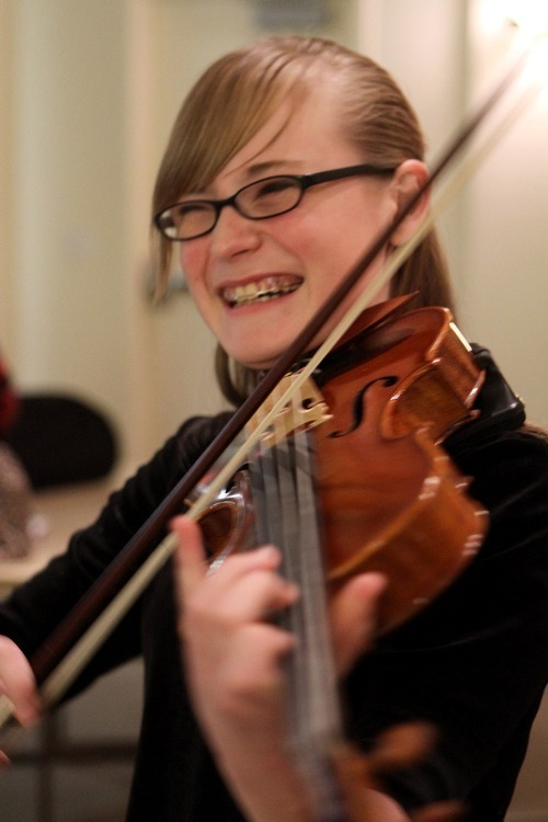 Stephen Holt | Special to The Salt Lake Tribune Student Rebecca Epperson, 13, plays the viola in a Gifted Music School concert in 2010 under the direction of director Eugene Watanabe.