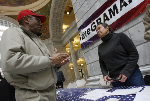 FRANCISCO KJOLSETH  |  The Salt Lake Tribune Jim Newsome, of Clinton, talks with Collette Gillian, of Salt Lake City, at a rally Thursday to collect signatures to repeal HB477, which limits public access to government records.
