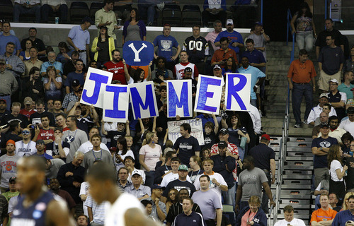 Scott Sommerdorf  |  The Salt Lake Tribune Fans of BYU guard Jimmer Fredette (32) show their support during second half play. BYU lost 83-74 in OT to Florida at the New Orleans Arena in their first round game of the