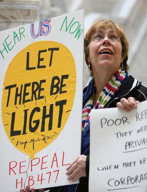 LEAH HOGSTEN  |  The Salt Lake Tribune Susan Bowlden joined about 50 people gathered in the Capitol Rotunda Friday to cheer on the repeal of HB477.