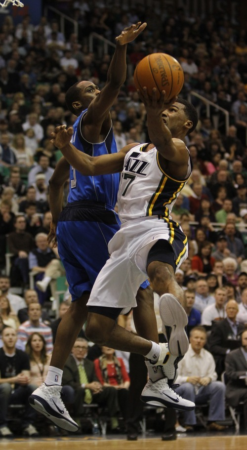 Rick Egan   |  The Salt Lake Tribune  Utah Jazz guard Ronnie Price (17)  goes up for a shot, as Dallas Mavericks guard Rodrigue Beaubois (3) defends, in NBA action Utah vs. Dallas, in Salt Lake City, Saturday, March 26, 2011.