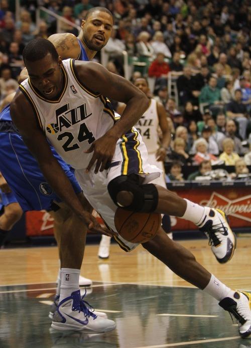 Rick Egan      The Salt Lake Tribune  Utah Jazz forward Paul Millsap (24)  gets tripped up on the ball, in NBA action Utah vs. Dallas, in Salt Lake City, Saturday, March 26, 2011.