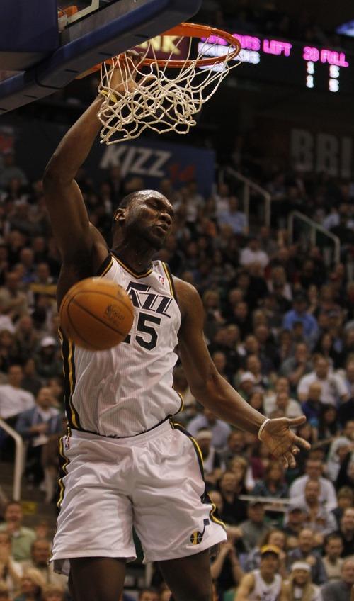 Rick Egan   |  The Salt Lake Tribune  Utah Jazz forward Al Jefferson (25) dunks the ball, in NBA action Utah vs. Dallas, in Salt Lake City, Saturday, March 26, 2011.