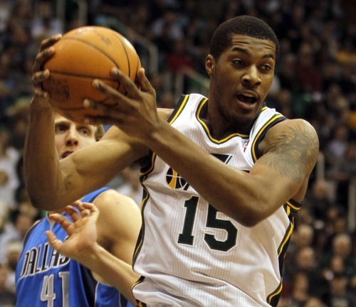 Rick Egan   |  The Salt Lake Tribune  Utah Jazz guard Derrick Favors grabs a rebound during a game against Dallas on March 26, 2011.