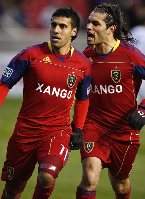 Djamila Grossman     The Salt Lake Tribune  Real Salt Lake's Javier Morales (11) and Fabian Espindola (7) celebrate after their team scored the second goal against Los Angeles Galaxy during a game at Rio Tinto Stadium in Sandy on Saturday,  March 26, 2011.