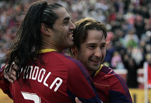 Djamila Grossman     The Salt Lake Tribune  Real Salt Lake's Ned Grabavoy (20) and Fabian Espindola (7) celebrate after their team scored the second goal against Los Angeles Galaxy during a game at Rio Tinto Stadium in Sandy, Utah, on Saturday,  March 26, 2011.