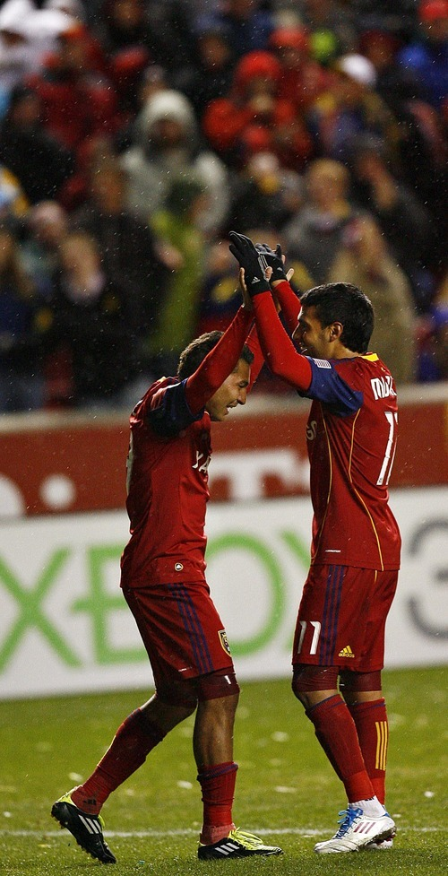 Djamila Grossman     The Salt Lake Tribune  Real Salt Lake's Javier Morales (11) and Paulo Araujo, Jr., react after their team scored a goal in the second half of a game against Los Angeles Galaxy during a game at Rio Tinto Stadium in Sandy, Utah, on Saturday,  March 26, 2011. RSL won the game.