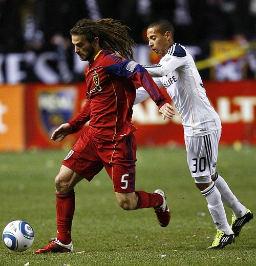Djamila Grossman     The Salt Lake Tribune  Real Salt Lake's Kyle Beckerman (5) defends the ball against Los Angeles Galaxy's Paolo Cardozo (30) during the second half of a game at Rio Tinto Stadium in Sandy, Utah, on Saturday,  March 26, 2011. RSL won the game.