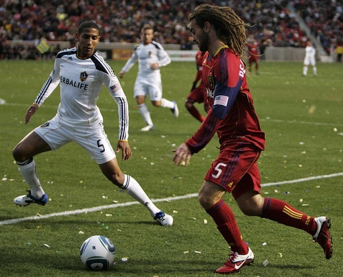 Djamila Grossman     The Salt Lake Tribune  Real Salt Lake's Kyle Beckerman (5), defends the ball against Los Angeles Galaxy's Sean Franklin (5) during the first half of a game at Rio Tinto Stadium in Sandy, Utah, on Saturday,  March 26, 2011. RSL won the game.