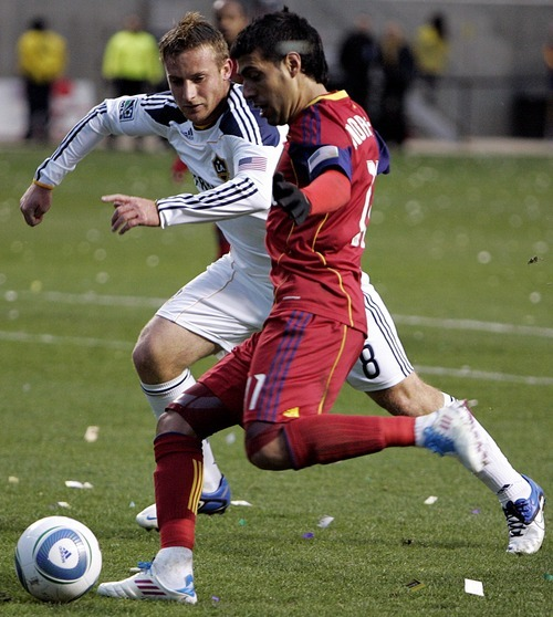 Djamila Grossman     The Salt Lake Tribune  Real Salt Lake's Javier Morales (11) goes in for the ball against Los Angeles Galaxy's Chris Birchall (8), during a game at Rio Tinto Stadium in Sandy, Utah, on Saturday,  March 26, 2011. RSL won the game.