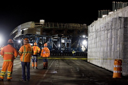 Djamila Grossman  |  The Salt Lake Tribune  Workers watch as the Sam White Bridge is being moved into place on I-15 at American Fork on Saturday, March 26, 2011. It is the longest two-span bridge ever moved on wheels - Self-Propelled Modular Transporters- in the western hemisphere.