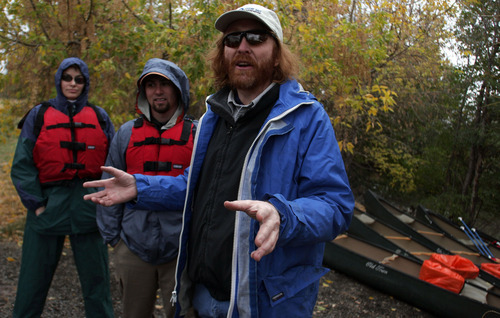 Tribune file photo   Jeff Salt explains the directions downstream to volunteers who were helping clean up the Jordan River in a 2005 project sponsored by the Great Salt Lakekeeper.