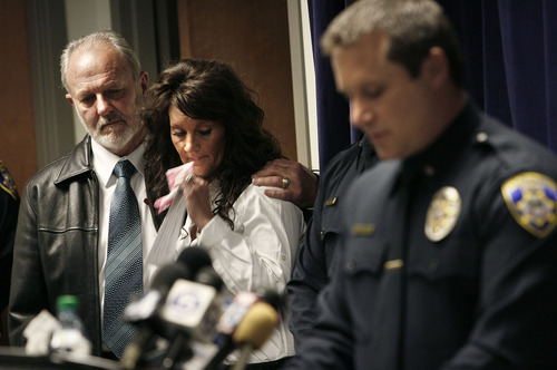 Scott Sommerdorf  |  The Salt Lake Tribune As South Salt Lake police lead investigator Dwyane Ruth speaks at right, Earl Black, husband of the victim Sherry Black, holds his daughter, Heidi Miller during a joint news conference with the Friends of Sherry Black organization to announce the latest developments in the Sherry Black homicide investigation, Monday, March 28, 2011. A $50,000 reward for information leading to the arrest and successful prosecution of the murderer was announced.