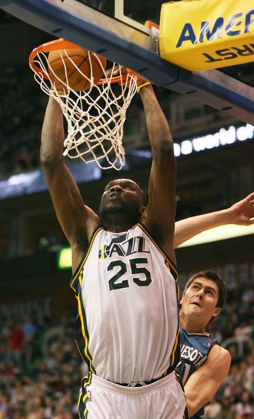 Steve Griffin  |  The Salt Lake Tribune    Utah Jazz forward Al Jefferson throws down a dunk during a game against the Timberwolves at EnergySolutions Arena  in Salt Lake City on Wednesday, March 16, 2011.