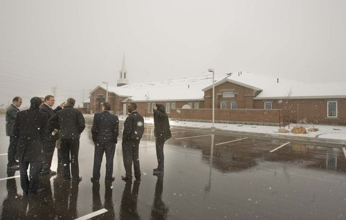 Paul Fraughton  |  The Salt Lake Tribune Jared Doxey, the director of architecture, engineering and construction for the LDS Church, recently shows a group of LDS church members the Farmington  West Stake Center, which is the church's pilot building for energy efficiency. Outside the building on a snowy spring day,  Doxey  points out the solar  panels on the roof.