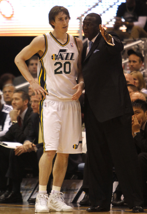 Rick Egan   |  The Salt Lake Tribune  Jazz Head coach Tyrone Corbin chats with Utah Jazz forward Gordon Hayward late in the game against the Washington Wizards on Monday, March 28, 2011.