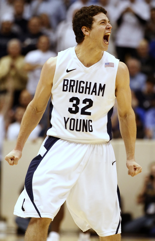George Frey  |  The Associated Press  BYU's Jimmer Fredette yells toward the crowd after making a 3-pointer against San Diego State in Provo on Jan. 26.