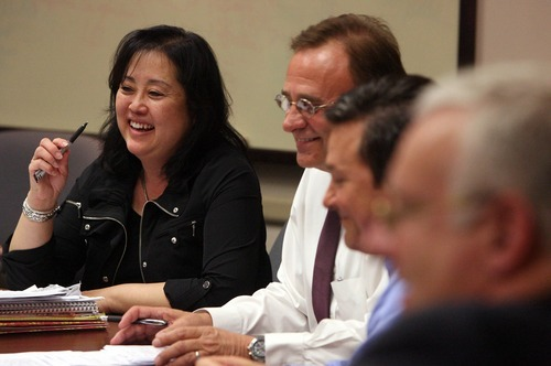 Leah Hogsten  |  The Salt Lake Tribune Salt Lake County Councilwoman Jani Iwamoto meets Thursday with fellow council members Max Burdick, center, and Michael Jensen.
