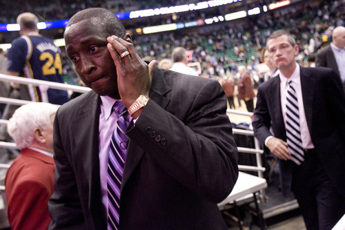 Jeremy Harmon  |  The Salt Lake Tribune  Utah Jazz head coach Tyrone Corbin leaves the court after losing his first game at the helm of the Jazz on Friday, February 11, 2011.