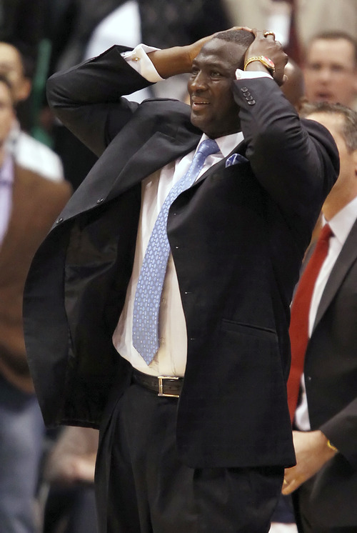 Utah Jazz head coach Ty Corbin puts his hands on his head during a game against the Washington Wizards during the second half of an NBA basketball game in Salt Lake City, Monday, March 28, 2011. The Wizards beat the Jazz in overtime 100-95. (AP photo/George Frey)