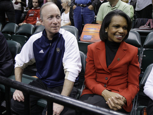 Indiana Gov. Mitch Daniels, left, and former Secretary of State Condoleezza Rice watch the first half of a women's NCAA Final Four semifinal college basketball game between Texas A&M and Stanford in Indianapolis, Sunday, April 3, 2011. (AP Photo/Michael Conroy)