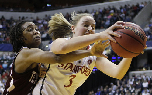 Texas A&M's Tyra White reaches in from behind on Stanford's Mikaela Ruef (3) in the first half of a women's NCAA Final Four semifinal college basketball game in Indianapolis, Sunday, April 3, 2011. (AP Photo/Mark Duncan)
