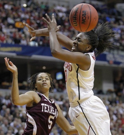 Texas A&M's Kristi Bellock (5) and Stanford's Nnemkadi Ogwumike go for a loose ball in the first half of a women's NCAA Final Four semifinal college basketball game in Indianapolis, Sunday, April 3, 2011. (AP Photo/Michael Conroy)