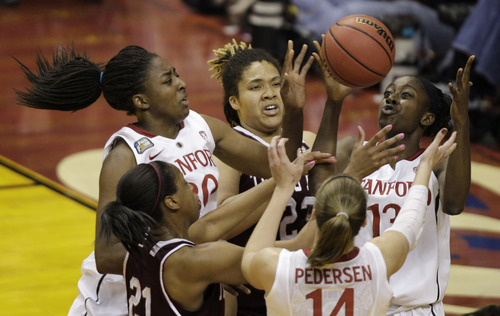 Stanford players Nnemkadi Ogwumike (30), Chiney Ogwumike (13) and Kayla Pedersen (14) go for a rebound against Texas A&M players Danielle Adams (23) and Adaora Elonu (21) in the first half of a women's NCAA Final Four semifinal college basketball game in Indianapolis, Sunday, April 3, 2011. (AP Photo/Amy Sancetta)