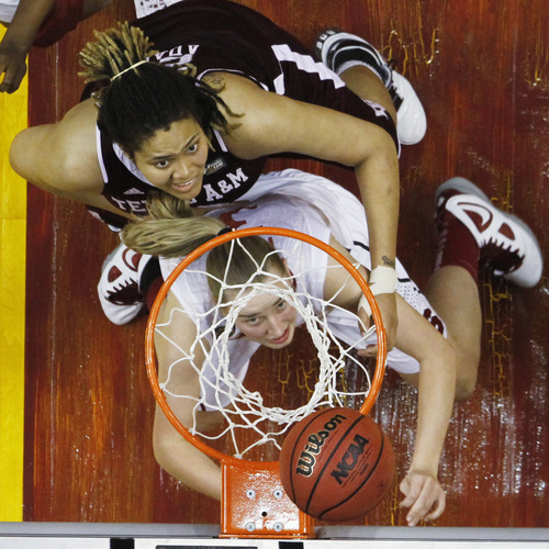 Stanford's Mikaela Ruef watches her shot as Texas A&M's Danielle Adams, top, defends in the second half of a women's NCAA Final Four semifinal college basketball game in Indianapolis, Sunday, April 3, 2011. (AP Photo/Michael Conroy)