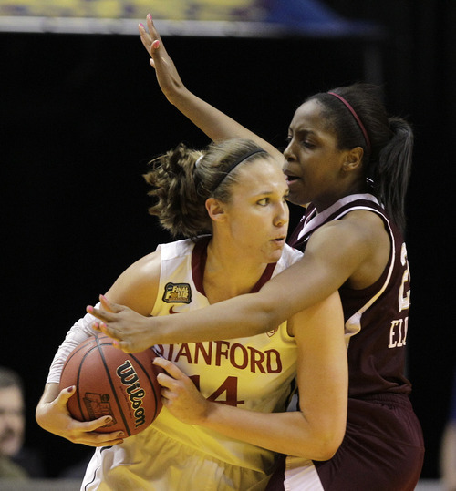 Texas A&M's Adaora Elonu reaches in for the ball against Stanford's Kayla Pedersen (14) in the first half of a women's NCAA Final Four semifinal college basketball game in Indianapolis, Sunday, April 3, 2011. (AP Photo/Mark Duncan)