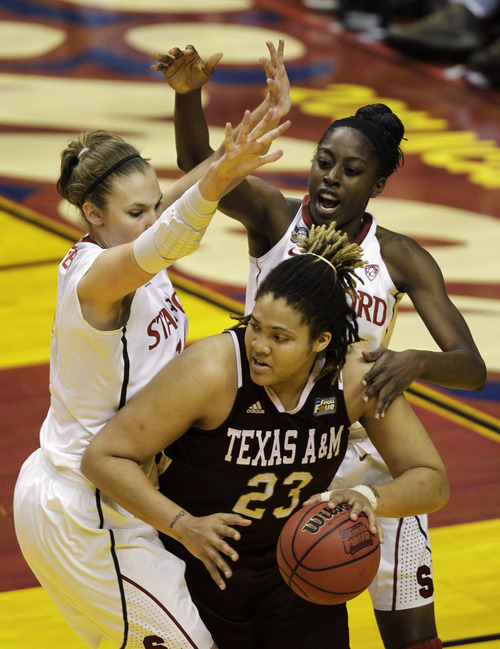 Texas A&M's Danielle Adams (23) is double teamed by Stanford's Kayla Pedersen, left, and Chiney Ogwumike in the first half of a women's NCAA Final Four semifinal college basketball game in Indianapolis, Sunday, April 3, 2011. (AP Photo/Amy Sancetta)