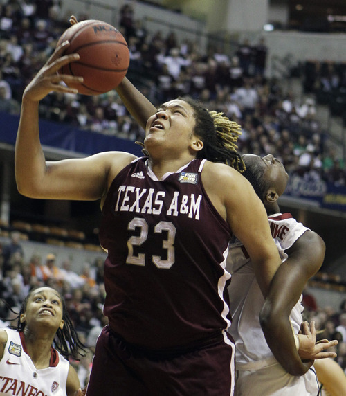 Texas A&M's Danielle Adams (23) fights for a rebound with Stanford's Nnemkadi Ogwumike in the first half of a women's NCAA Final Four semifinal college basketball game in Indianapolis, Sunday, April 3, 2011. (AP Photo/Mark Duncan)