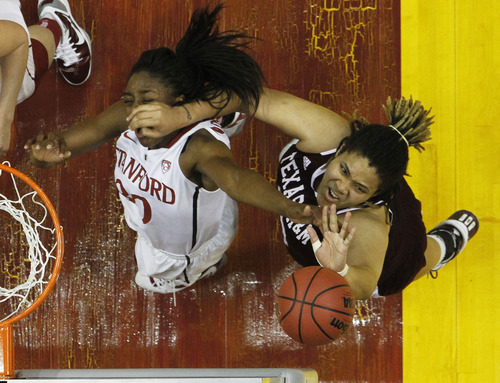 Stanford's Nnemkadi Ogwumike (30) and Texas A&M's Danielle Adams fight for a rebound in the first half of a women's NCAA Final Four semifinal college basketball game in Indianapolis, Sunday, April 3, 2011. (AP Photo/Michael Conroy)