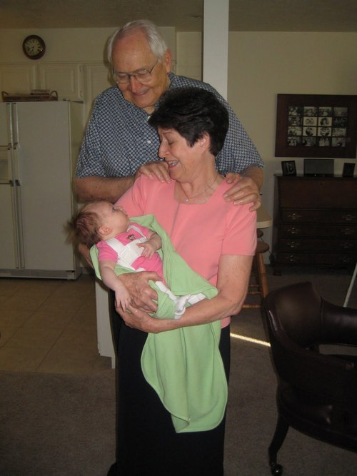 L. Tom Perry and his wife, Barbara, holding a great-granddaugher, Jane Thomas.  Courtesy of the family.