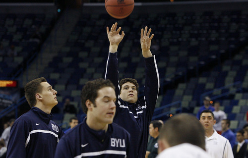 Scott Sommerdorf  |  The Salt Lake Tribune Jimmer Fredette warms up at the New Orleans Arena for their first round game of the