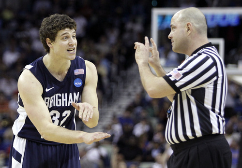 BYU's Jimmer Fredette (32) reacts to a call during the first half of the NCAA Southeast regional college basketball semifinal game against Florida Thursday, March 24, 2011, in New Orleans. (AP Photo/Patrick Semansky)