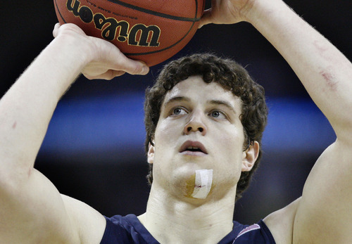 Scott Sommerdorf  |  The Salt Lake Tribune BYU guard Jimmer Fredette (32) shows the battles scars on his chin and forearm from the game against Florida during this second half free throw. BYU lost 83-74 in OT to Florida at the New Orleans Arena in their first round game of the