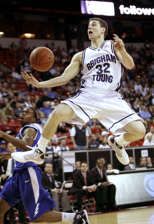 Rick Egan  |  The Salt Lake Tribune  Jimmer Fredette takes flight against Air Force at the Mountain West Conference tournament in 2009.