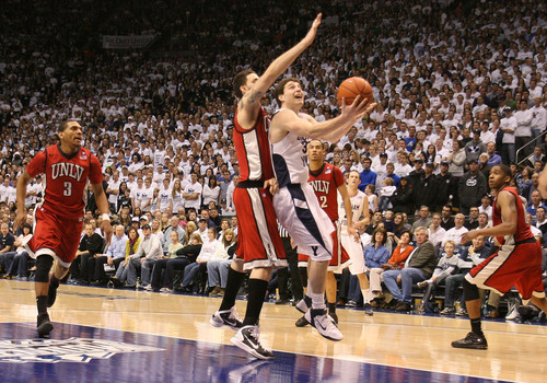 Leah Hogsten  |  The Salt Lake Tribune  Jimmer Fredette drives past UNLV defenders at the Marriott Center on Feb. 5.