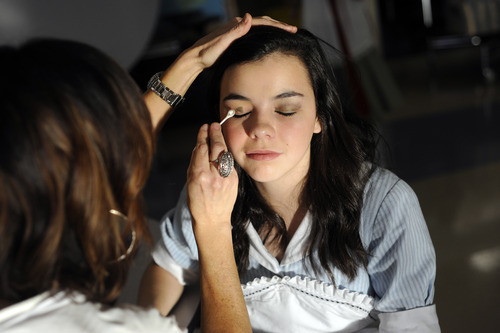 Sarah A. Miller  |  The Salt Lake Tribune  Isabel Austin, 14, has her makeup done by parent volunteer Suzanne Winchester before the performance of