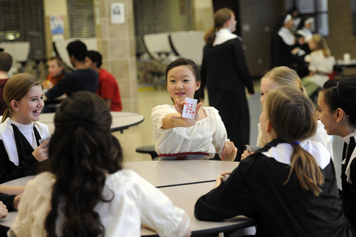Sarah A. Miller  |  The Salt Lake Tribune  Jean Noh, 12, plays a card game with other ensemble members to pass time before the performance of