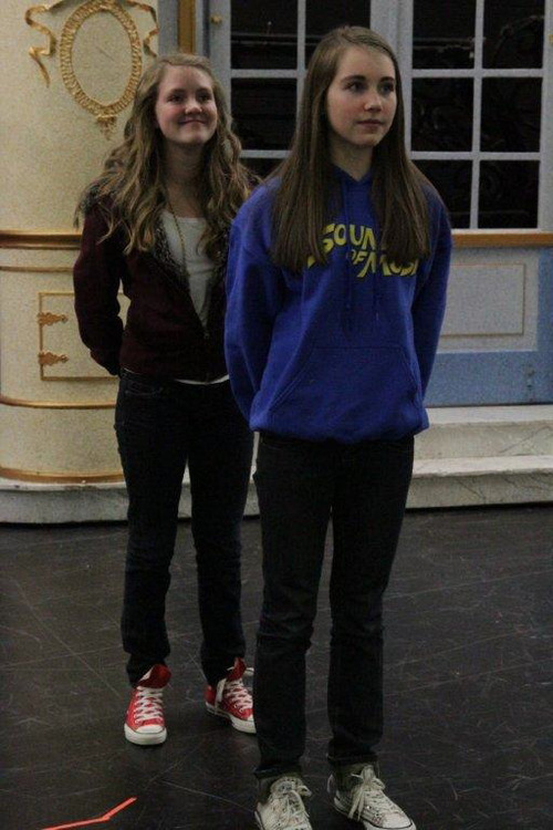 Sophia King (back) and Janelle Jacobs (as Brigitta) in Clayton Middle School's production of